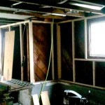 Before seismic retrofit: Basement wall framing furred out